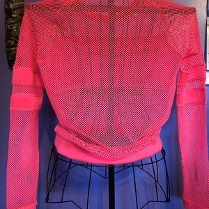 Mesh shirt. Wear over a cami or bathing suit.